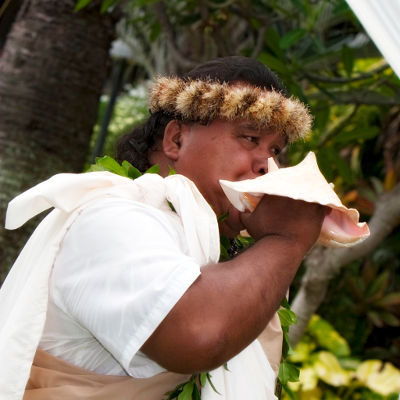 Person playing conch shell